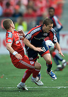 23 May 09: New England Revolution midfielder Chris Tierney #8 and Toronto FC midfielder Carl Robinson #33 in action during a game between the New England Revolution and Toronto FC.Toronto FC won 3-1.