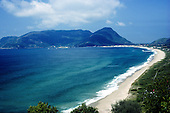 Ilha de Sta Catarina, Brazil. Morro das Pedras, Armacao; long, curving sandy beach with granite hills.