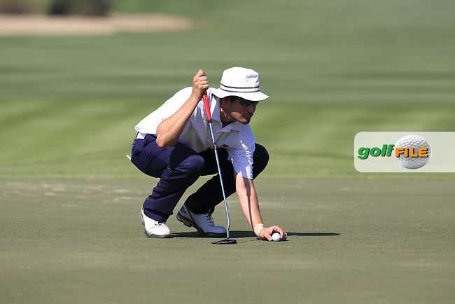 Michael Harradine (AM)(SUI) on the 10th green during Thursday's Round 1 of the 2015 Omega Dubai Desert Classic held at the Emirates Golf Club, Dubai, UAE.: Picture Eoin Clarke, www.golffile.ie: 1/29/2015