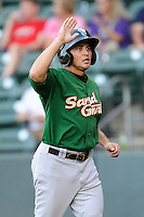 Center fielder Patrick Biondi (5) of the Savannah Sand Gnats, is congratulated after scoring a run in a game against the Greenville Drive on Sunday, July 5, 2015, at Fluor Field at the West End in Greenville, South Carolina. Savannah won, 8-6. (Tom Priddy/Four Seam Images)