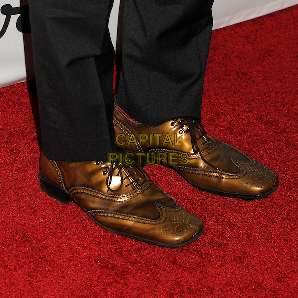"JOHN CHO's .Oxfam America and Esquire House LA Host ""The Oxfam Party"" held at Esquire House LA, Los Angeles, California, USA, .18th November 2010..detail bronze brown shoes feet .CAP/ADM/BP.©Byron Purvis/AdMedia/Capital Pictures."