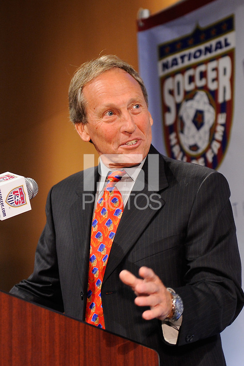 Bob McNabb presents inductee Preki Radosavljevic (not pictured) during the induction ceremony for the National Soccer Hall of Fame at the New Meadowlands Stadium in East Rutherford, NJ, on August 10, 2010.