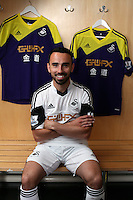 Pictured: Leon Britton with home kit.<br /> Re: Official launch of the 2013-2014 Swansea City Football Club kit launch, with sponsors Goldenway GWFX at the Liberty Stadium, Swansea, south Wales. Friday 28th of June 2013