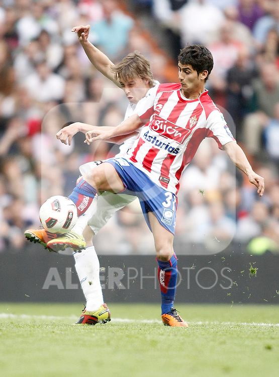 Real Madrid's Sergio Canales against Sporting de Gijon's Jose Angel during La Liga Match. April 02, 2011. (ALTERPHOTOS/Alvaro Hernandez)