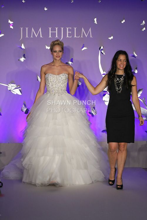 Fashion designer Francesca Pitera walks runway with model, at the close of the Jim Hjelm Fall 2011 fashion show, at JLM Couture.