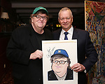 Michael Moore And Max Klimavicius during the Michael Moore And Michael Mayer portrait unveilings as they join the Wall of Fame at Sardi's on September 21, 2017 at Sardi's in New York City.