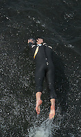 11 AUG 2007 - NOTTINGHAM, UK - A competitor dives into the water after tagging - British Club Relay Triathlon Championships. (PHOTO (C) NIGEL FARROW)