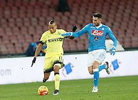 Jonathan Biabiany challenges Napoli's David Lopez  during the Quartef-final of Tim Cup soccer match,between SSC Napoli and vFC Inter    at  the San  Paolo   stadium in Naples  Italy , January 20, 2016