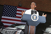 United States President Barack Obama delivers remarks after touring the The Federal Highway Administration's Turner-Fairbank Highway Research Center July 15, 2014 in McLean, Virginia. According to the Department of Transportation, the center is home to '20 laboratories, data centers, and support facilities, and conducts applied and exploratory advanced research in vehicle-highway interaction, nanotechnology, and a host of other types of transportation research in safety, pavements, highway structures and bridges, human-centered systems, operations and intelligent transportation systems, and materials.'  <br /> Credit: Chip Somodevilla / Pool via CNP