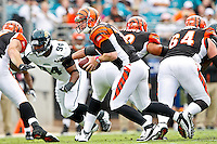 October 09, 2011:   Cincinnati Bengals quarterback Andy Dalton (14) prepares to hand off during first half action between the Jacksonville Jaguars and the Cincinnati Bengals played at EverBank Field in Jacksonville, Florida.  ........