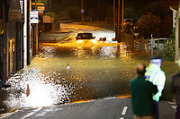 Pictured: A car attempts to pass the flooded closed off Old Station Road in Carmarthen, Wales, UK. Saturday 13 October 2018<br /> Re: River Towy has burst its banks and adjacent properties have flooded, caused by storm Callum, in Carmarthen, west Wales, UK.