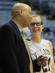 Bishop McGuinness' Sarah Coon smiles at head coach Brian Robinson during the Villains' 7th-consecutive state title win, a new state record, over Southside High School, at the Dean Smith Center in Chapel Hill, NC, on Saturday, March 10, 2012.  Photo by Ted Richardson