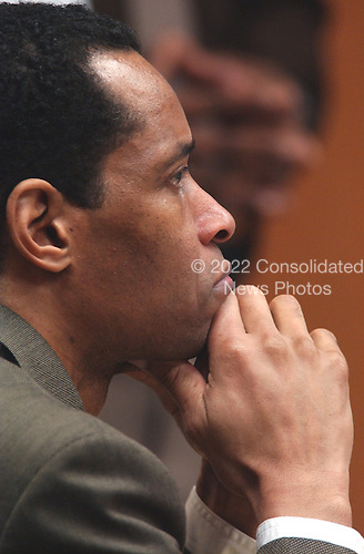 Sniper suspect John Allen Muhammad, seated left, listens to testimony during his trial in courtroom 10 at the Virginia Beach Circuit Court in Virginia Beach, Virginia on October 27, 2003.<br /> Credit: Davis Turner - Pool via CNP
