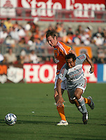 Houston Dynamo midfielder Nate Jaqua (21)attempts to push FC Dallas midfielder Arturo Alvarex (12) off the ball.  Houston Dynamo defeated FC Dallas 1-0 in an MLS regular season match at Robertson Stadium in Houston, TX on August 19, 2007.