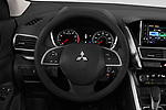 Car pictures of steering wheel view of a 2018 Mitsubishi Eclipse Cross ES 2WD 5 Door SUV