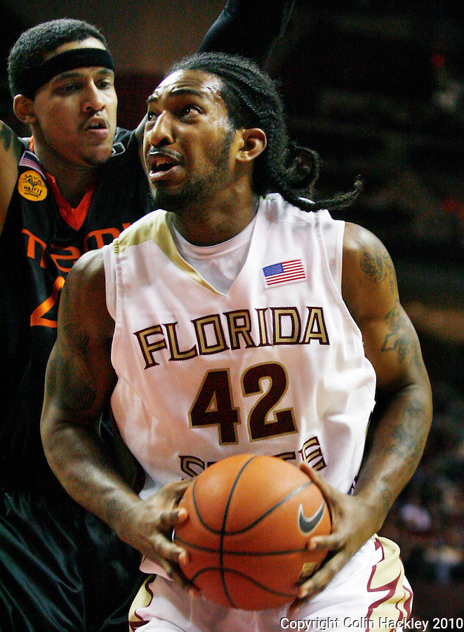TALLAHASSEE, FL 2/6/10-FSU-MIAMI BB10 CH21-Florida State's Ryan Reid tries to get around Miami's Julian Gamble during second half action Saturday at the Donald L. Tucker Center in Tallahassee. The Seminoles beat the Hurricanes 71-65...COLIN HACKLEY PHOTO