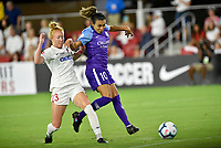 WASHINGTON, DC - AUGUST 24: Orlando Pride forward Marta (Marta Vieira da Silva) (10) tips a ball in to tie the game at 1-1 while Washington Spirit midfielder Tori Huster (23) defends during the National Women's Soccer League (NWSL) game between the Orlando Pride and Washington Spirit August 24, 2019 at Audi Field in Washington, D.C.. (Photo by Randy Litzinger/Icon Sportswire)