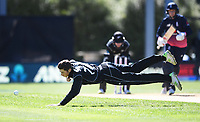 Mitchell Santner dives off his own bowling.<br /> New Zealand Black Caps v England, ODI series, University Oval in Dunedin, New Zealand. Wednesday 7 March 2018. &copy; Copyright Photo: Andrew Cornaga / www.Photosport.nz