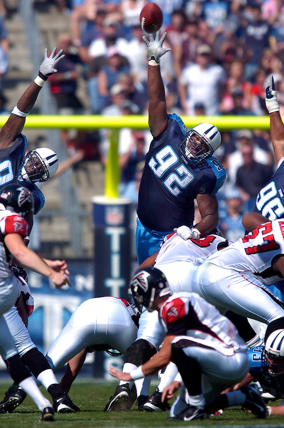 Tennessee Titans defensive tackle Albert Haynesworth leaps to block a field goal attempt by the Atlanta Falcons during a game in the 2007 NFL season.
