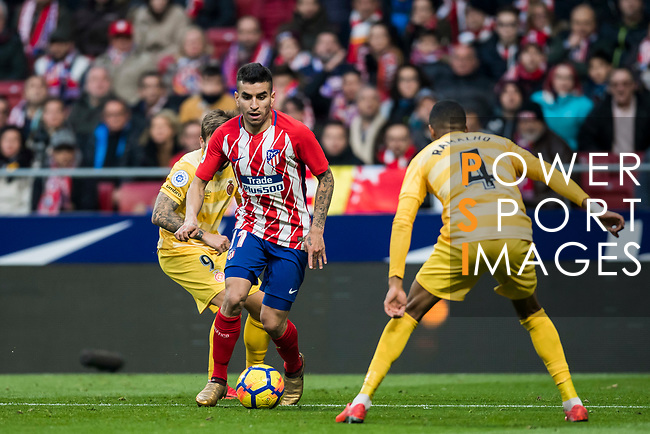 Angel Correa (C) of Atletico de Madrid is tackled by Jonas Ramalho Chimeno of Girona FC during the La Liga 2017-18 match between Atletico de Madrid and Girona FC at Wanda Metropolitano on 20 January 2018 in Madrid, Spain. Photo by Diego Gonzalez / Power Sport Images