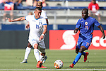13 July 2015: Erick Andino (HON) (15) and Pascal Millen (HAI) (11). The Haiti Men's National Team played the Honduras Men's National Team at Sporting Park in Kansas City, Kansas in a 2015 CONCACAF Gold Cup Group A match. Haiti won the game 1-0.
