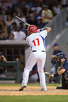 Urmany Guerra Vargas (17) of the Cuban National Team at bat against the US Collegiate National Team at BB&T BallPark on July 4, 2015 in Charlotte, North Carolina.  The United State Collegiate National Team defeated the Cuban National Team 11-1.  (Brian Westerholt/Four Seam Images)