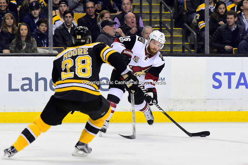 Tuesday, February 28, 2017: Arizona Coyotes left wing Max Domi (16) lines up a pass with pressure from Boston Bruins center Dominic Moore (28) during the National Hockey League game between the Arizona Coyotes and the Boston Bruins held at TD Garden, in Boston, Mass. Boston defeats Arizona 4-1. Eric Canha/CSM
