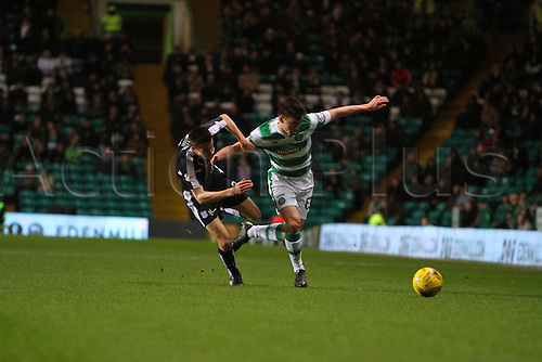02.03.2016. Celtic Park, Glasgow, Scotland. Scottish Premier League. Celtic versus Dundee. Kieran Tierney holds off the challenge of Craig Wighton