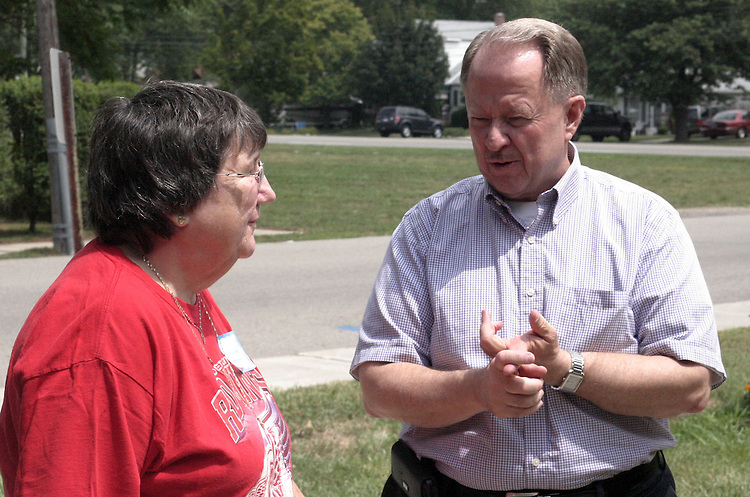 UNITED STATES - JULY 27: State Sen. Glenn Anderson (D) talks to a food pantry volunteer outside Redford Interfaith Relief in Redford Township near Detroit. (Photo By Shira Toeplitz/CQ Roll Call)