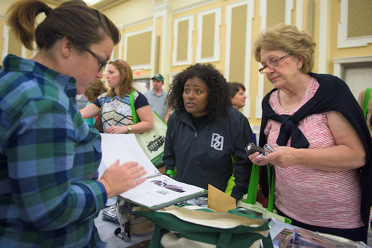 Lindsey Meyers of the Ohio University Promo Shop speaks with Phyllis Bohning, right and Winsome Chunny, left, during the 1st Annual Supplier Fair at Ohio University's Baker Center Ballroom on September 7, 2016.