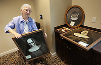 NWA Democrat-Gazette/DAVID GOTTSCHALK Sister Maria Goretti De Angeli, the prioress, speaks about portraits they will keep from the previous St. Scholastica Monastery Thursday, May 9, 2019, while standing in the new St. Scholastica Monastery in Fort Smith. The nuns of St. Scholastica Monastery moved in January from their very large almost century-old building into a smaller convent. They are selling hundreds of items at auction beginning Thursday.
