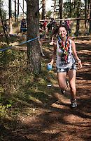 Girl running in the conquest world at Quest. Photo: Audun Ingebrigtsen / Scouterna