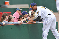 Burlington Bees first baseman Jeyson Sanchez (30) gives his autograph to young fans prior to a game against the South Bend Cubs at Community Field on May 10, 2017 in Burlington, Iowa.  The Bees won 4-3 in 10 innings.  (Dennis Hubbard/Four Seam Images)