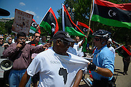July 9, 2011 (Washington, DC)  U.S. Park Police remove a man causing a disturbance, as protestors for and against NATO bombing in Libya clash in front of the White House.  Opponents consider U.S. military action in Libya unjustified and illegal.  Those in favor military action believe the bombing is necessary to oust Gaddafi.  As the intensity of the rally increased, police moved barricades between the two groups to keep them separated. (Photo by Don Baxter/Media Images International)