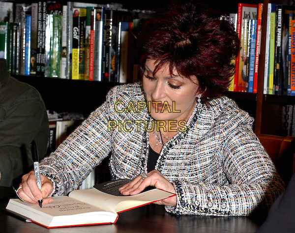 "SHARON OSBOURNE.signs the Osbourne family's new book ""Ordinary People: Our Story"" at the Barnes & Noble at The Grove at .Farmers Market in Los Angeles, California.19 February 2004                                                                                                                              *UK Sales Only*.signing autographs.www.capitalpictures.com.sales@capitalpictures.com.©Capital Pictures."