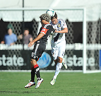 Nick DeLeon (18) of D.C. United heads the ball against Todd Dunivat (2) of the Los Angeles Galaxy.  D.C. United tied the Los Angeles Galaxy 2-2, at RFK Stadium, Saturday September 14 , 2013.
