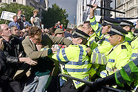 London, England, 15/09/2004..An estimated 20,000 hunt supporters demonstrate in Parliament Square as a new bill to ban hunting with dogs is passed. Some demonstrators fought with riot police, and five hunt supporters managed to get onto the House of Commons floor during the debate..Demomstrators fight with police in an attempt to block the roads around Parliament.