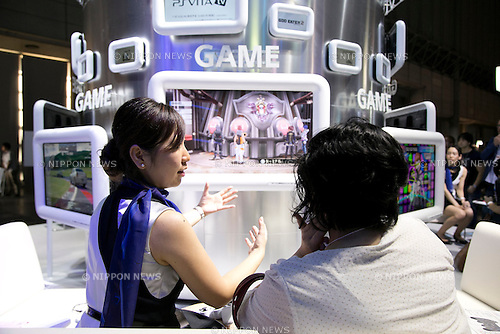 A exhibitor explains to visitor how to use the PSVITA at Tokyo Game Show,  September 20, 2013. The Tokyo Game Show one of the world's biggest trade show for video game developers brings exhibitors from 33 different countries and regions, 352 companies and organizations, opens from September 19 to 22 at the International Convention Complex Makuhari Messe in Chiba. (Photo by Rodrigo Reyes Marin/AFLO)