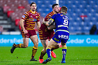 Picture by Alex Whitehead/SWpix.com - 08/02/2018 - Rugby League - Betfred Super League - Huddersfield Giants v Warrington Wolves - John Smith's Stadium, Huddersfield, England - Huddersfield's Oliver Roberts is tackled by Warrington's Daryl Clark.