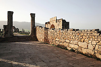 Rear side of the entrance to the House of the Columns near the Triumphal Arch of Caracalla, built 217 AD, Volubilis, Northern Morocco. Volubilis was founded in the 3rd century BC by the Phoenicians and was a Roman settlement from the 1st century AD. Volubilis was a thriving Roman olive growing town until 280 AD and was settled until the 11th century. The buildings were largely destroyed by an earthquake in the 18th century and have since been excavated and partly restored. Volubilis was listed as a UNESCO World Heritage Site in 1997. Picture by Manuel Cohen