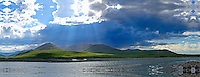 A rainstorm passes over the tundra covered hills along the Kongakut River in Alaska's Arctic National Wildlife Refuge.
