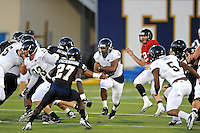 30 March 2012:  FIU's Jeremiah Harden (6) carries the ball at the FIU Football Spring Game at University Park Stadium in Miami, Florida.