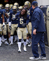 Cam Saddler shakes hands with head coach Paul Chryst. The Pitt Panthers defeat the Rutgers Scarlet Knights 27-6 on Saturday, November 24, 2012 at Heinz Field , Pittsburgh, PA.