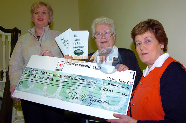 Pam McGuinness centre handing over a cheque for Û1000 to Bernie Kelly Ch.person of Drogheda Hospice Homecare and Carmel Freeman Tre. Drogheda Hospice Homecare...Photo Fran Caffrey Newsfile.ie..This Picture has been sent to you by Newsfile Ltd..The Studio,.Millmount Abbey,.Drogheda,.Co. Meath,.Ireland..Tel: +353(0)41-9871240.Fax: +353(0)41-9871260.ISDN: +353(0)41-9871010.www.newsfile.ie..general email: pictures@newsfile.ie