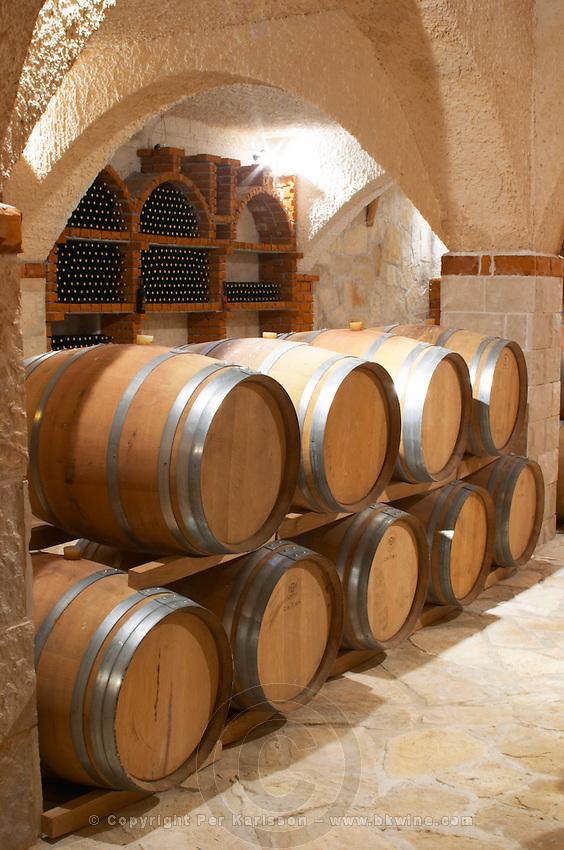 Vaulted wine cellar with oak barrels. Matusko Winery. Potmje village, Dingac wine region, Peljesac peninsula. Matusko Winery. Dingac village and region. Peljesac peninsula. Dalmatian Coast, Croatia, Europe.