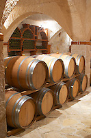 Vaulted wine cellar with oak barrels. Matusko Winery. Potmje village, Dingac wine region, Peljesac peninsula. Matusko Winery. Dingac village and region. Peljesac peninsula. Dalmatian Coast, Croatia, Europe.