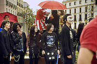 "Spain. Province of Madrid. Madrid. A group of young people celebrate the ""Feliz Dia  Frikis"". May 25th is the International Freak Pride's Day. The word freak when used in a slang context also has positive connotations. It can be used to describe one who denotes a strong fondness or even obsession with a particular activity, like a passion for Star wars and wearing dark clothes. Downtown. Town center. Santo Domingo place. Carnical mask. © 2007  Didier Ruef."