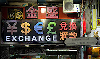 HONG KONG, MAY 08: A currency exchange booth shows symbols of different currencies including Hong Kong dollars and Chinese yuans (RMB), on May 8, 2015, in Hong Kong. (Photo by Lucas Schifres/Pictobank)