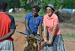 Sister Raquel Peralta (right), a Catholic nun from Paraguay, helps women pump water from a well in a camp for more than 5,000 displaced people in Riimenze, in South Sudan's Gbudwe State, what was formerly Western Equatoria. Families here were displaced at the beginning of 2017 as fighting between government soldiers and rebels escalated.<br /> <br /> Peralta is a member of the Missionary Sisters Servants of the Holy Spirit, and works in South Sudan as part of Solidarity with South Sudan, an international network of Catholic groups working in the newly independent country. Solidarity and Caritas Austria have both supported efforts by the diocese to ensure that the displaced families here have food, shelter and water.