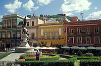 Tourist looking at statues in the Plaza de la Paz in the city of Guanajuato, Mexico